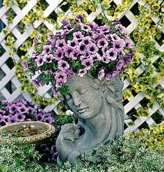 An unusual container can highlight a plant the way this elegant pot turns purple petunias into a floral pompadour.