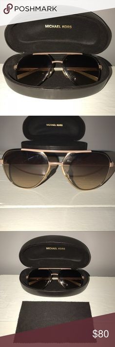 Michael Kors Aviator Sunglasses Michael Kors aviator sunglasses. Authentic. Worn once, just not really my preferred style. Brown lenses with brownish-taupe hardware. Super pretty! Comes with original MK brown leather case and cleaning cloth. Perfect condition, no scratches on lenses, wear, etc. Michael Kors Accessories Sunglasses