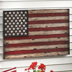 Display your patriotism with pride—American Flag Wall Art  indoors or out. Hand-painted, embossed metal flag has a weathered, rustic appearance.