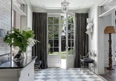 Curtains Over Dining Room Sliding Door (heavy curtains provide draft and light control as well as color or pattern if you choose)