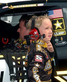 🎂 September 26 Birthday: #NASCAR star Joe Nemechek (1963) 🇺🇸 U.S. Army photo by William Thurmond Joe Nemechek prepares to start Sunday's MBNA RacePoints 400 NASCAR race while his son, John Hunter, looks on.