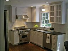 Small kitchen inspiration glass-front white kitchen cabinets, black coutertops, school house lights… right up my alley. Small House Kitchen Ideas, Small Kitchen Inspiration, Small Kitchen Layouts, Kitchen Small, Kitchen White, Kitchen Designs, Nice Kitchen, Stylish Kitchen, Awesome Kitchen