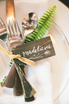 Place Setting with wooden tag + calligraphy. Lovely detail. See the wedding on SMP: http://www.StyleMePretty.com/2014/02/28/botanical-inspired-wedding-at-marvimon/ onelove photography
