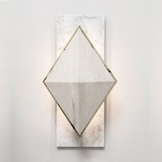 What a fantastic wall sconce that mixes wood and marble. Fancy but not stuffy. Ines Sconce | Shine by S.H.O Bespoke