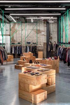 furniture store studio mutt designs vibrant store for universal works in coal drops yard, london Clothing Store Interior, Clothing Store Design, Boutique Interior, Clothing Store Displays, Clothing Studio, Clothing Racks, Clothing Stores, Shoe Store Design, Retail Store Design