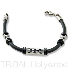ANGELCATCHER Beaded Black Rubber Bracelet representing the Desire for Enlightenment. The black rubber bracelet contains three beautifully crafted beads inscribed with a unique tribal tattoo design. The central bead is flanked by two identical beads. Tattoo Bracelet, Skull Bracelet, Ring Bracelet, Rubber Bracelets, Bracelets For Men, Beaded Bracelets, Black Leather Bracelet, Leather Cuffs, Mens Silver Jewelry