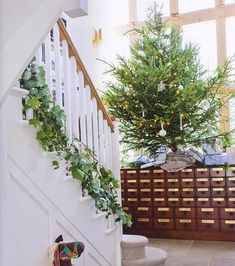 christmas love the idea at the bottom of the banister so the kids can still hold on when walking up/down