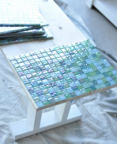 Buckie, DIY Tile Table.  For that rolling bed table you are making me!