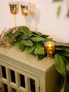 DIY Magnolia Leaf Garland, could be used to create an altar arch or as table runners. Could also put flowers in with leaves
