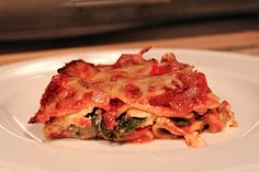 vegetarian lasagna: Whole wheat lasagna noodles + zucchini + red bell peppers + baby spinach + red onion  Garlic + Dried oregano + Dried basil + Fresh thyme + crushed tomatoes (with Italian spices added–like basil, oregano) + spaghetti sauce + Fat-free ricotta cheese + mozzarella + Parmesan or 4 cheese blend