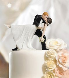 Romantic Dip Couple Cake Topper (Color Options) (Wedding Star 9209) | Buy at Wedding Favors Unlimited (http://www.weddingfavorsunlimited.com/a_romantic_dip_bride_and_groom_cake_topper.html).