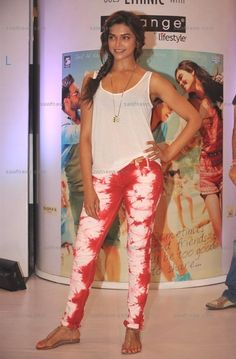 Deepika Padukone looked toned and tormenting in a Isabel Marant Ipa tie-dye red and white skinny jeans and white tank at the launch of Cocktail inspired collection of ethnic wear by Melange at Lifestyle Store in Phoenix Mills, Mumbai on Thursday, July 5, 2012.