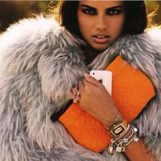 Adriana Lima - I think I have that charm bracelet...