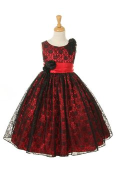 Love love love this classic beautiful dress. Stunning lace overlay fabric that is classically styled on this dress. This dress would be stunning on any holiday card. Sash comes on the dress with coordinating flowers and it ties in the back for a perfect bow in the back. The dress is fully lined for complete coverage to ensure that your princess stays comfortable.  Zipper Back. Do not miss out on this dress! Proudly made in the USA.   NOTE: Detail photos on the dress are shown in Fuchsia…