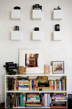I just love the way photographer Rachel Thurston displays these awesome vintage cameras in her home. Old Cameras, Vintage Cameras, Display Shelves, Wall Shelves, Hat Display, Display Ideas, White Cube Shelves, Floating Shelves, Apartment Therapy
