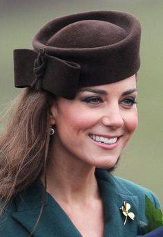 For her first solo military engagement at the St Patricks Day parade, the Duchess wore a lovely Lock & Co hat complete with a chunky bow just to emphasis her femininity among all those macho soldiers.