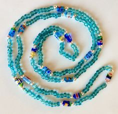 Beaded necklace with millefiore beads that also serves as a bracelet when wind it round your wrist a few times. Check out the several varieties and other items in my shop. Beaded Necklace, Necklaces, Bracelets, Hippie Jewelry, Peace And Love, Times, Beads, Check, Shopping
