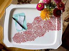 Floral Tray (need: old tray and stand  sandpaper (fine grit)  rust primer spray paint  patterned paper  x-acto knife   re-positionable adhesive  colored spray paint (base color and pattern color)  scrap paper and cardboard)