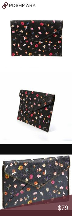Rebecca Minkoff Floral Clutch Gorgeous Floral Clutch by Rebecca Minkoff Feminine and Flirty. Perfect for every occassion. Rebecca Minkoff Bags Clutches & Wristlets