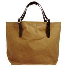"""Cotton canvas tote with snap closure and leather adjustable buckle handles. Unlined interior with zipper pocket.  16"""" x 23"""" x 8"""" 11"""" handle drop"""
