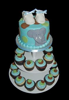 blue brown and green elephant baby shower cupcake tower by Simply Sweets.. maybe do this without the shoes for a first birthday party?! Top is the smash cake and then cupcakes for everyone else?