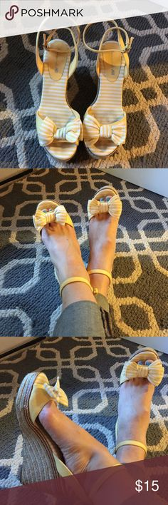 Yellow and raffia wedge sandals American Eagle brand cute yellow and raffia wedge Sanford with wrap-around ankle strap. Gently used, a little wear, but no rips or tears American Eagle by Payless Shoes Sandals