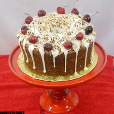 Decadent Vanilla Cinnamon Swirl Pound Cake Soaked in a vanilla rum syrup filled with a cinnamon pecan streusel top with cinnamon pecan streusel decorated with white chocolate cream cheese frosting sprinkle with Saigon cinnamon and garnish with red cherries