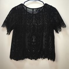 Lace Black Mid Top I wouldn't say this is a crop top but definitely not a long shirts it's a beautiful black lace with floral design. Worn once to a photo shoot. It also doesn't have a size tag. I would say medium but can fit a large Tops Crop Tops