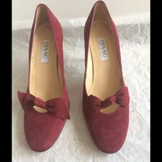 {Isaac by Isaac Mizrahi} Maroon Pump These heels are amazing! Only worn a couple times, they are very comfortable! They have some padding at the balls of the feet and are a wine colored suede. They come in their original box! Isaac Mizrahi Shoes