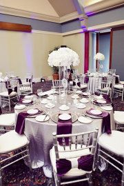 guest table- not crazy about all the white but I love the gray and purple and the chairs