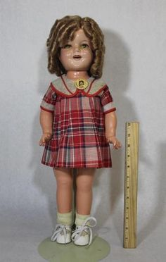 sort of cute, sort of creepy SHirley Temple doll... why is her face and neck so shiny....?