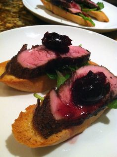 Spiced, roasted pork on a rosemary garlic crostini with port braised cherries
