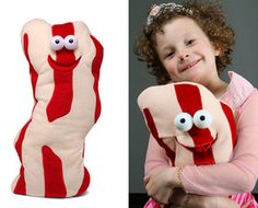 """My First Bacon  Barbie, bike, and tooth are all words that commonly follow """"My First"""" when it comes to children. Bacon? Not so much. But don't tell that to the clever folks at Think Geek. This bacon plushie says """"I'm Bacon!"""""""