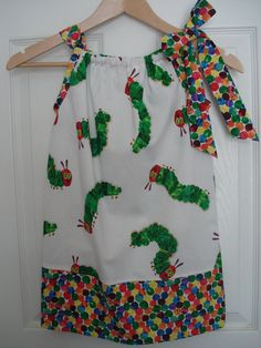 very hungry caterpillar dress...maybe with the fruit fabric in the middle instead.