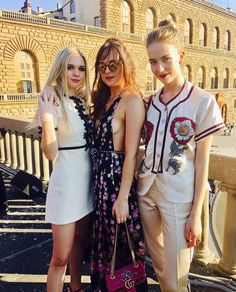 Dakota with sisters Stella and Grace at the Gucci Cruise 2017 in Italy