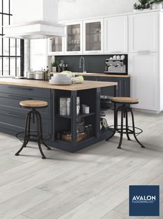 Can't beat flooring that's both stylish and waterproof--like laminate flooring!nn#laminateflooring #kitchendesign #interiordesign
