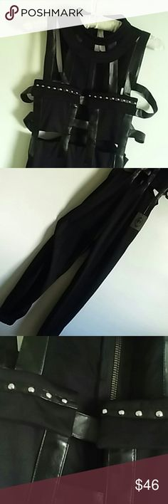 JUMPSUIT BLACK WITH FAUX LEATHER STRIPS STUDS ACROSS THE CHEST PICTURE 4 shows elasti  ankles...yay! Medium TOY Pants Jumpsuits & Rompers