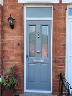 A Ludlow 2 composite door in French grey with Victorian glass and brushed aluminium hardware. Installed in West Bridgford, Nottingham. For a free quotation call us on 01158 660066 or pop into our West Bridgford showroom. Grey Composite Front Door, Solidor Door, Window Company, House Front Door, French Grey, Nottingham, Quotation, Showroom, Tall Cabinet Storage