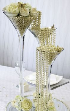 white pearls and roses wedding centerpiece