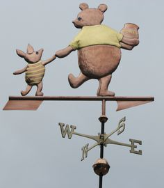 Winnie and Piglet stroll hand in hand carrying a pot of honey in this charming Weathervane. Their shirts, and the honey pot have been enhanced with gold leafing.