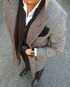 Men fashion black and white coat, brown shoes, brown scarf