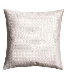 Valkoinen/Kuviollinen. Tyynynpäällinen, jossa jakardikudottu etupuoli ja yksivärinen taustapuoli puuvillakangasta. Piilovetoketju.