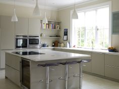 Contemporary kitchen in a Victorian house. Kitchen by Cambridge Kitchens, floor tiles from Worlds End Tiles, pendant lights from Mr Light, wall paint colour Paint Library Stone 3. Interior design by Angel and Blume, photography by Simon Whitmore