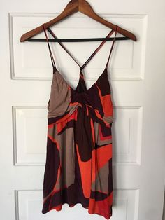 "Women's French Connection tank top in purple, red, and gray geometric abstract print. Empire waist with twist back. Size M. Length: 29"". Underarm to underarm: 16"". 
