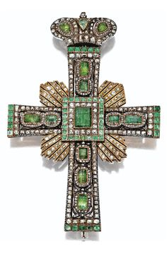 Diamond and beryl pectoral cross, mid 19th Century. The closed-back mounting decorated throughout with emerald-cut and pear-shaped beryls, some foil-backed, as well as with old-mine and rose-cut diamonds, the centre with a table-cut beryl engraved with the scene of the Crucifixion, mounted in silver and gold, later mounted as a brooch, surmounted by a Russian-style Imperial crown similarly decorated with beryls and diamonds. With fitted case stamped Wartski. #antique #PectoralCross