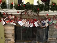 Fun way to display Christmas cards. Decorated wood clothes pins with glitter and hang a clothesline to your mantle. Clip your cards and enjoy all season