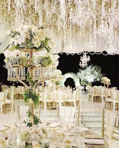 With overhead hanging #florals and statement #centrepieces, this #Jakarta-based wedding featuring #chandeliers is truly astounding. | Photography By: Axioo and Andreas Hartanto | WedLuxe Magazine | #luxury #wedding #luxurywedding #weddinginspiration  #tablescape #decor #floral #eventdesign #centrepiece