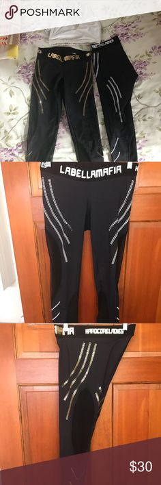 Labella Mafia leggings with matching sports bra. Leggings size Small. Sports bra Small. Leggings with white on the side are worn a few times. Gold on the side are never worn and brand new as of this year! Mesh on the sides also. Pants Leggings
