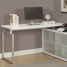 Bring style and function to your office with this must-have desk, showcasing an L-shaped design, side cabinets, and frosted glass doors. Top it with a tall white orchid and miniature Zen garden for a serene study spot.