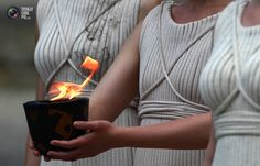 Actress, playing role of priestess, carries cauldron with Olympic flame during torch lighting ceremony of London 2012 Olympic Games at site of ancient Olympia in Greece. JOHN KOLESIDIS/REUTERS